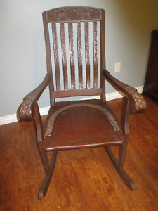 indonesian rocking chair with carvings