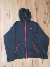 For sale is a Nike hoodie.