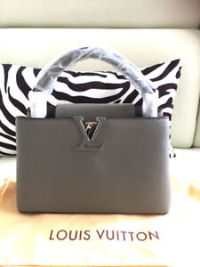 New Gorgeous Leathered Louis Vuitton CAPUCINES PM purse
