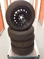 4 Goodyear Nordic tires with rims:195/65R15