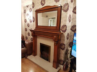 Oak fireplace with solid marble hearth and backing, matching mirror and inset electric fire