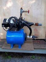 Pompe à eau avec réservoir