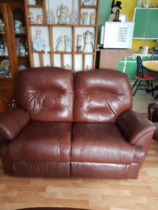 Brown leather Love seat .