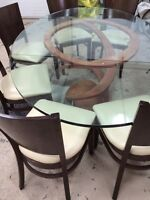 Glass table and solid wood chairs