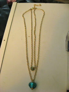 Gold coloured 2 strand necklace, green stones