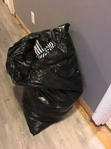 Garbage bag full of girls clothes - (small -med)