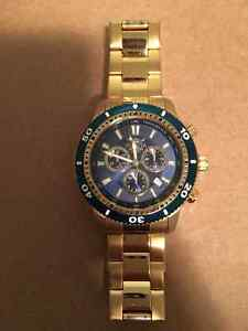 Beautiful Gold-Colored/Blue Face Invicta Watch