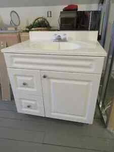 White vanity with sink and faucet