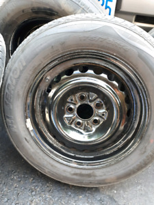 4 -14inch steel rims with 2 good all season tires ( 5x100 bolt)