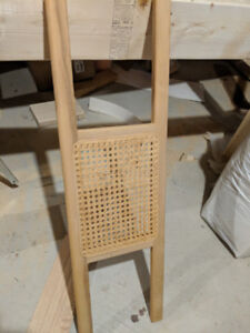 Wood canoe seat with pressed webbing