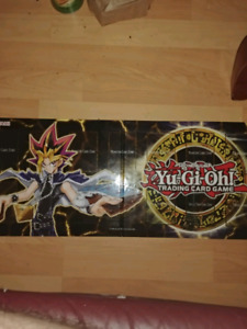Tons of yugioh cards and game mats *read description*