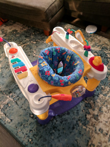 Infant's exercise/music activity saucer