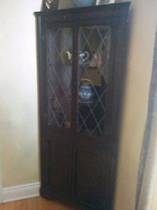 Antique wooden corner cabinet with leaded glass