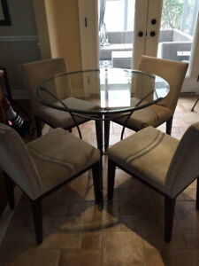 Glass Kitchen table and 4 upholstered chairs