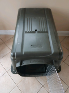 Extra Large dog kennel in like new condition.