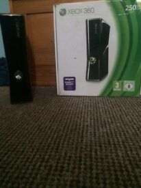 Xbox 360 like new got it 4 months ago comes with 2 pads and 20 games