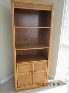 a Sklar Pepplar Oak Specialty Display Cabinet.