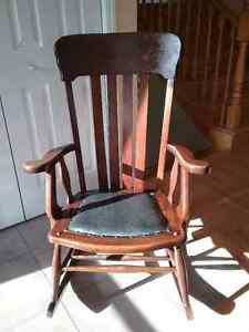 Antique wooden rocker with leather seat.