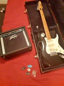 Peavey electric guitar, amp and case
