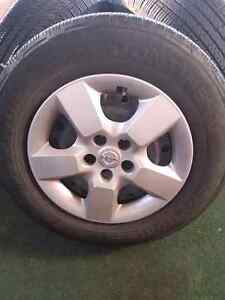 """2013 nissan rogue tires  16"""" steel rims with hubcaps and tires"""