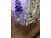 GLASS DINING TABLE WITH FOUR WHITE FAUX LEATHER CHAIRS