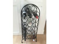 Cast iron wine rack holds 20 bottles.
