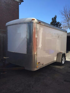 2010 6x12 Enclosed Trailer Stealth with Ramp and Built Shelves