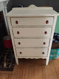 White dresser with red hardware