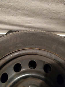 Four 14 in. rims with Bridgestone Insignia 200SE tires West Island Greater Montréal image 1