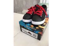Nearly brand new worn once Heeleys black and red size 1 with box. £25