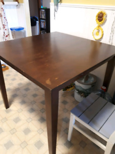 Pub height table and two chairs