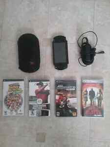 PSP  Barely Used!! comes with 3 games, a movie, power cord, case
