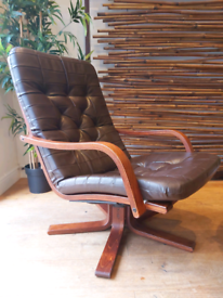 Mid century vintage Danish style leather swivel chair