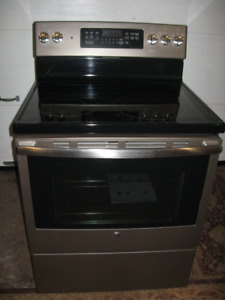 G.E. SELF CLEANING CONVECTION GLASS TOP STOVE.