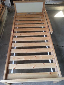 Toddler bed with slats and a mattress for sale $8