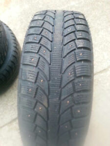 245 65 17 Ford Edge Winter studded tires on steelies with sensor