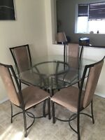 Glass top with 4 chairs. Mint condition.