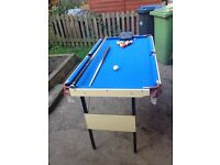 Pool table with balls and signed cues