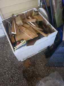 Box full of wood pieces