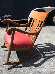 "antique ""tiger"" oak rocker,  new red leather seat"