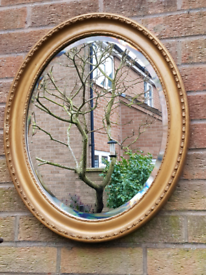 Antique oval bevelled edge mirror 60cm BY 50cm