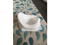 Blue and white unused Potty