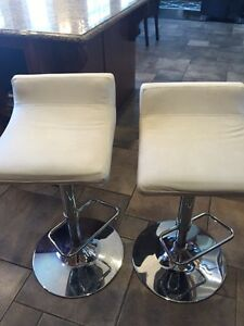 2 leather -like bar stools