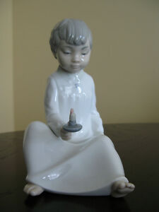 Boy with candle. Nao by Lladro fine porcelain figurine.
