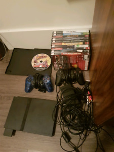 PS2 slim, two controllers, and 11 games for sale