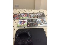 Ps3 console & 7 games