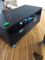 Looking to trade for a larger TV stand. Will pay more for it.