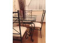 Solid glass and metal dining set