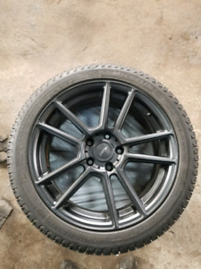 245/40/18 michelen x ice on fast nemesis rims for bmw