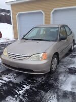 Tan Honda Civic sedan manual